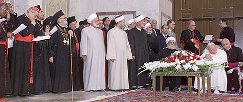 Syria's Grand Mufti Sheikh Ahmad Kuftaro, seated left, meets Pope John Paul II  at the Umayyad Mosque compound in old Damascus